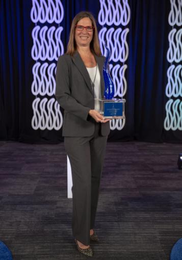 Deanna Obregon holding award