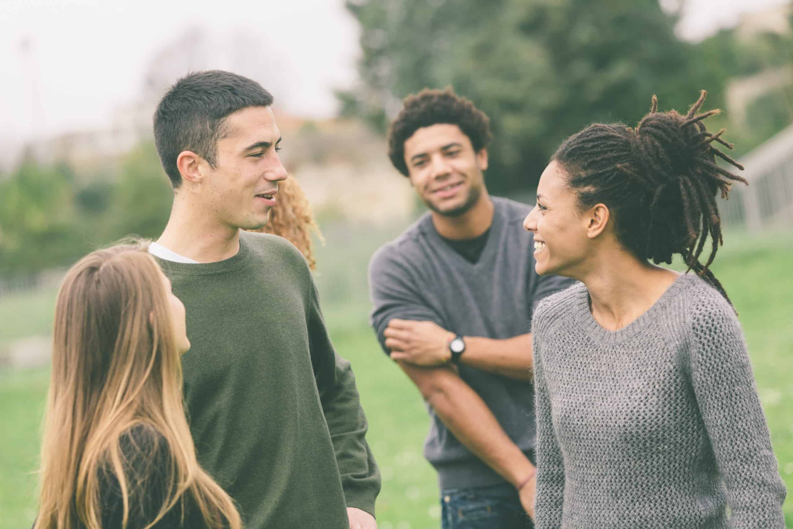 group of young adults talking